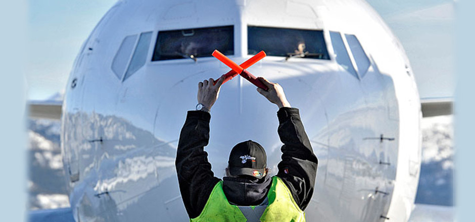 Ian Stewart/Yukon News An Air North 737 is guided into position by ground crew at the Whitehorse airport in 2012.